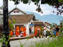people chasing monks luang prabang