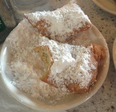 Guys, I admit it: I ate my beignets (ahem -- all three of them) before I even thought to take a picture. So credit for this one goes to the lovely, brilliant, and oh-so-thoughtful Mel Grier.